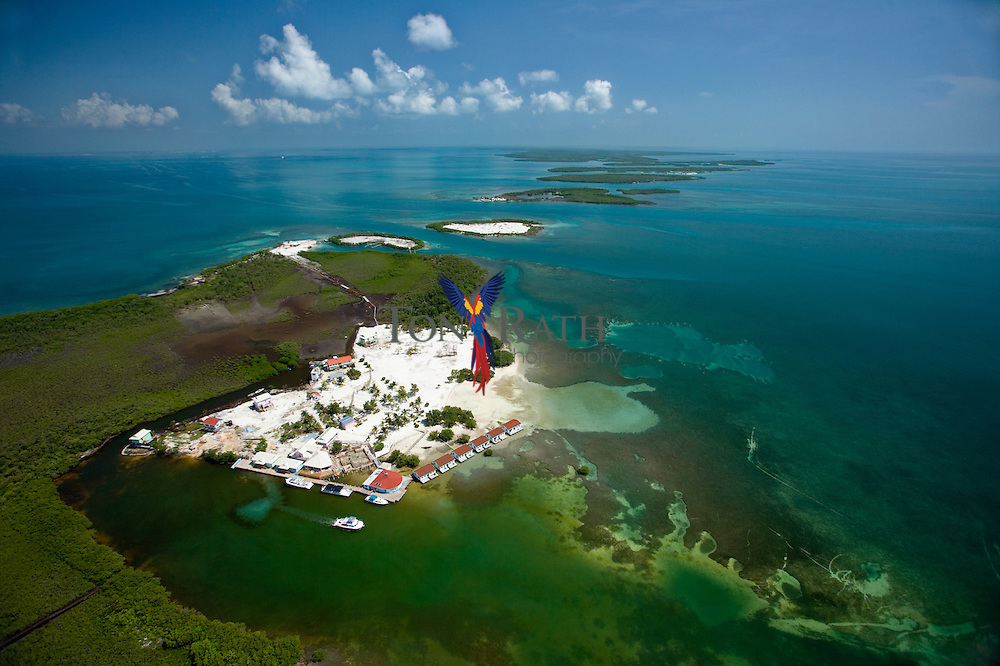 Aerial view of Hugh Parkey's Belize Adventure Lodge, Spanish Lookout Caye and Drowned Caye in the background, Belize