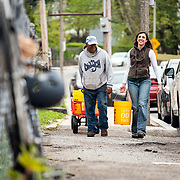 05/10/2017 - Boston, Mass. - Rachel Holmes of The Nature Conservancy and Apolo Catala Farm Manager for Codman Square Neighborhood Development Corp carry water to the OASIS on Ballou for a tree planting on May 10th, 2018. (Ian MacLellan for The Trust for Public Land)