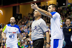 Referre and Dragan Gajic #30 of Slovenia during handball match between National teams of Slovenia and Ukraine in 6th Round of 2015 Men's World Championship Qualifications of Group 3 on January 12, 2014 in Rdeca dvorana, Velenje, Slovenia. (Photo by Urban Urbanc / Sportida)