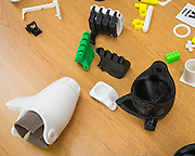 Parts are on display during a presentation of a prosthetic arm created with a 3D printer to 6-year-old Gracie at Washington High School, November 2, 2015.