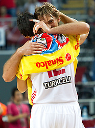 Semih Erden of Turkey and Kerem Gonlum of Turkey celebrate during the quarter-final basketball match between National teams of Turkey and Slovenia at 2010 FIBA World Championships on September 8, 2010 at the Sinan Erdem Dome in Istanbul, Turkey.  (Photo By Vid Ponikvar / Sportida.com)