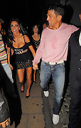 19.SEPTEMBER.2009 - LONDON<br /> <br /> KATIE PRICE LEAVING THE TROXY THEATRE, EAST LONDON AT 11.30PM WEARING A TOP WITH CHAMP ON IT AFTER GOING TO WATCH BOYFRIEND ALEX REID COMPETE IN A KICK BOXING MATCH SHE WAS JOINED BY MICHELLE HEATON, HORSE TRAINER ANDREW GOULD AND A COACHFULL OF OTHER GUESTS. ALEX CAME OUT 10 MINUTES LATER BRUISED AND WITH WATER ALL OVER HIM, THEY THEN HEADED ONTO MOVIDA CLUB AND KATIE WORE ALEX'S NEW BELT THAT HE HAD WON INTO THE CLUB. THEY STAYED TILL 3.00AM AND BOTH LEFT LOOKING VERY WORSE FOR WEAR WITH KATIE NEARLY FALLING OUT HER TOP AND ALEX BLEEDING ON HIS EYEBROW WHICH NEEDED A PLASTER. THEY THEN WENT TO THE BRITISH LUXURY CLUB AND PARTIED TILL 5.30AM BEFORE CALLING IT A NIGHT.<br /> <br /> BYLINE: BLOOMS/EDBIMAGEARCHIVE.COM<br /> <br /> *THIS IMAGE IS STRICTLY FOR UK NEWSPAPERS &amp; MAGAZINES ONLY*<br /> *FOR WORLDWIDE SALES &amp; WEB USE PLEASE CONTACT EDBIMAGEARCHIVE - 0208 954-5968*