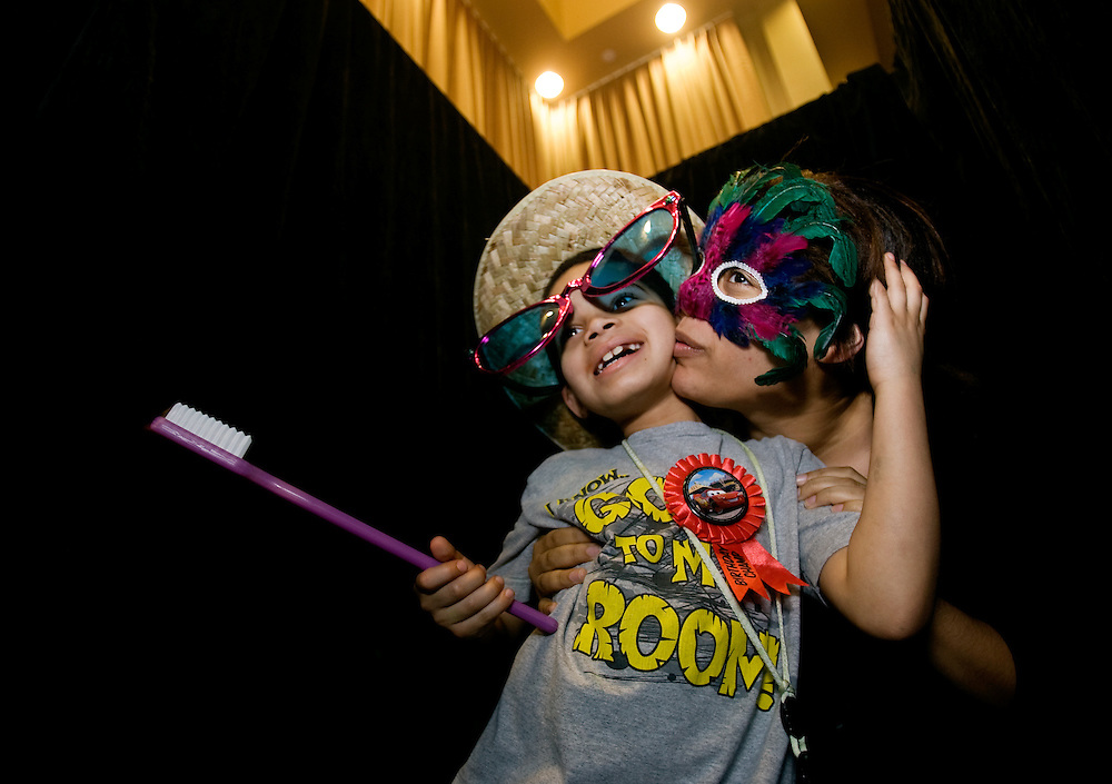 Arika May, a freshman at Ohio University, hams it up with her younger brother, Javon Johnson,8, in the photo booth set up at Baker Center during Sibs Fest. The event, which featured a magician, games, karaoke, and etc., was organized by the UPC (University Program Council)