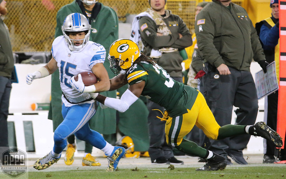Detroit Lions wide receiver Golden Tate (15) is knocked out of bounds by Green Bay Packers cornerback Davon House (31) in the 3rd quarter. <br /> The Green Bay Packers hosted the Detroit Lions at Lambeau Field Monday, Nov. 6, 2017. STEVE APPS FOR THE STATE JOURNAL.