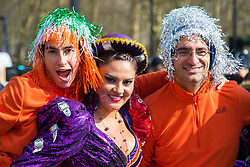 London, March 13th 2016. The annual St Patrick's Day Parade takes place in the Capital with various groups from the Irish community as well as contingents from other ethnicities taking part in a procession from Green Park to Trafalgar Square.  PICTURED: In-line skaters pose with a Bolivian dancer. &copy;Paul Davey<br /> FOR LICENCING CONTACT: Paul Davey +44 (0) 7966 016 296 paul@pauldaveycreative.co.uk