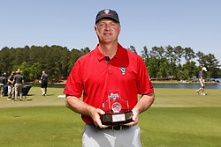 Terry Harvey poses with the Celebrity Longest Drive trophy during the Chick-fil-A Peach Bowl Challenge at the Oconee Golf Course at Reynolds Plantation, Sunday, May 1, 2018, in Greensboro, Georgia. (Paul Abell via Abell Images for Chick-fil-A Peach Bowl Challenge)