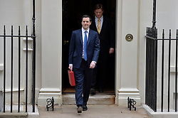 The Chancellor George Osborne and Danny Alexander (behind) leave No11 Downing street with the red budget box for the 2014 Budget, London, United Kingdom. Wednesday, 19th March 2014. Picture by Ben Stevens / i-Images