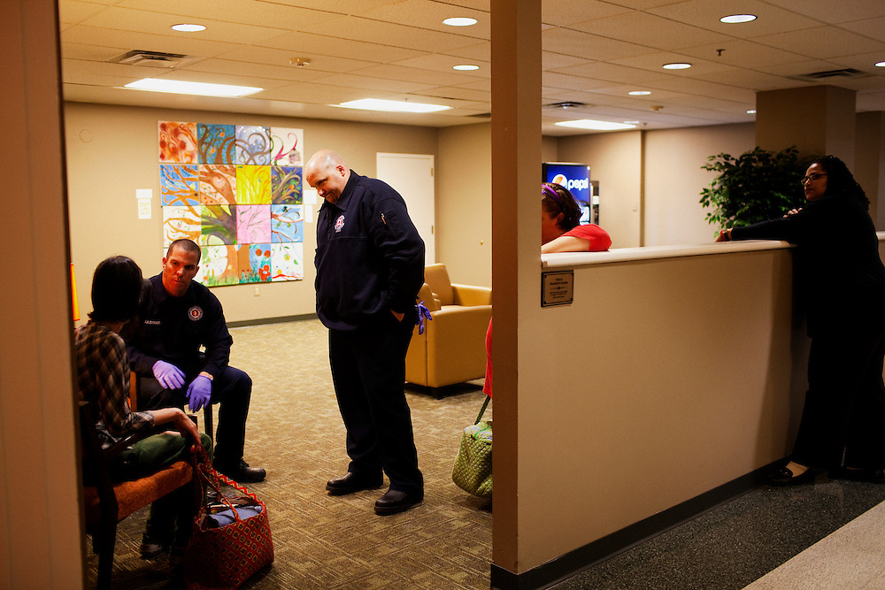 (L-R) John Anderson and Ryan Moody from Fire House 1 in Columbus, Ohio respond to a call at the YWCA on Thursday, February 24, 2011. Senate Bill 5 would eliminate collective bargaining rights for state workers, which Governor John Kasich claims is a necessary reaction to the budget crisis. These cuts would directly affect state workers such as firefighters, paramedics and police officers.