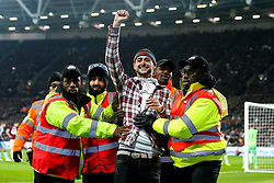 A pitch invader is escorted off the pitch by stewards - Mandatory by-line: Robbie Stephenson/JMP - 31/10/2018 - FOOTBALL - London Stadium - London, England - West Ham United v Tottenham Hotspur - Carabao Cup