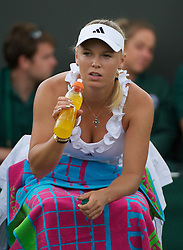 24.06.2011, Wimbledon, London, GBR, Wimbledon Tennis Championships, im Bild Caroline Wozniacki (DEN) in action during the Ladies' Singles 2nd Round match on day five of the Wimbledon Lawn Tennis Championships at the All England Lawn Tennis and Croquet Club, EXPA Pictures © 2011, PhotoCredit: EXPA/ Propaganda/ *** ATTENTION *** UK OUT!