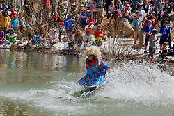 """""""Cushing Classic at Squaw Valley 25"""" - Photograph of a skier crossing a pond during the Cushing Classic at Squaw Valley, USA."""