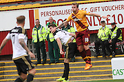 Josh Law challenges Kenny Mclean during the Ladbrokes Scottish Premiership match between Motherwell and Aberdeen at Fir Park, Motherwell, Scotland on 15 August 2015. Photo by Craig McAllister.