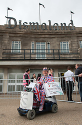 © Licensed to London News Pictures. 21/08/2015. Weston-super-Mare, North Somerset, UK.  Terry Hutt in union jack colours is the first member of the public through the doors as the Dismaland show by BANKSY and other artists opens to the public at the old Tropicana on Weston sea front. The first day is exclusively for local people, some of whom queued through the night for a free ticket. Photo credit : Simon Chapman/LNP