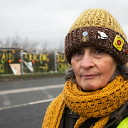 """Pauline Jones.<br /> """" I have been coming for two years. I am slightly hopeful but it is not to be easy because they got the government on their side. It sounds to me that the government wants to push the blame onto the Environment Agency and the regulators, to make them change the traffic system which worries me a bit.""""<br /> It is Green Monday and first week of the second anniversary of Cuadrilla's fracking exploration in Preston New Road. For two years activists have been keeping an eye on the fracking company Cuadrilla from the roadside of the fracking site in Preston New Road. The company has not actively fracked since November and is currently seemingly busy emptiyng the site for heavy equipment. Prostesters and climate protectors are still by the gates trying to work out Cuadrilla's intensions."""