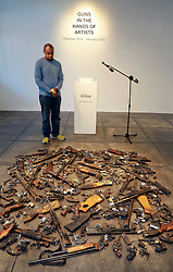 16 April 2014. Jonathan Ferrara Gallery, New Orleans, Louisiana. <br /> Artist John Barnes at the The Jonathan Ferrara Gallery as part of the 'Guns In The Hands Of Artists' project where artists take parts from 190 destroyed weapons acquired by the New Orleans Police department through a buy-back program and convert them into art.  <br /> Photo; Charlie Varley/varleypix.com