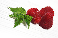 Raspberries on white background - studio shot