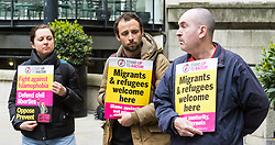 London, April 28th 2017. Anti-discrimination protesters disrupt the launch of UKIP's election campaign at the Marriot County Hall in Westminster. PICTURED: Three of the protesters wait for UKIP Leader Paul Nuttall to emerge from the Marriot County Hall hotel.<br /> Credit: ©Paul Davey