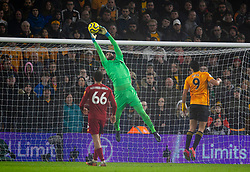 WOLVERHAMPTON, ENGLAND - Thursday, January 23, 2020: Liverpool's goalkeeper Alisson Becker makes a save during the FA Premier League match between Wolverhampton Wanderers FC and Liverpool FC at Molineux Stadium. (Pic by David Rawcliffe/Propaganda)