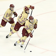 Austin Cangelosi #26 of the Boston College Eagles, Patrick Brown #23 of the Boston College Eagles, and Danny Linell #10 of the Boston College Eagles skate up the ice during The Beanpot Championship Game at TD Garden on February 10, 2014 in Boston, Massachusetts. (Photo by Elan Kawesch)