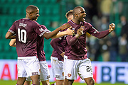 Clevid Dikamona (#28) of Heart of Midlothian and Arnaud Djoum (#10) of Heart of Midlothian celebrate at the final whistle of the Ladbrokes Scottish Premiership match between Hibernian FC and Heart of Midlothian FC at Easter Road Stadium, Edinburgh, Scotland on 29 December 2018.