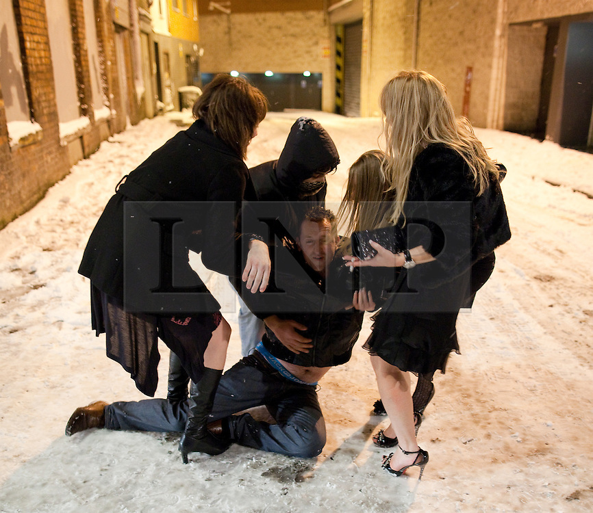 """© under license to London News Pictures. 18/12/2010 as snow blizzards hit Manchester revellers continue their """"Mad Friday"""" night out. Many fell on treacherous ice"""