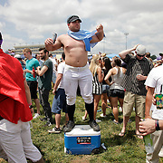 At the Derby for a bachelor party, Gene Janke, from Madison, Wisconsin, dances atop his cooler in the infield at the 138th running of the Kentucky Derby at Churchill Downs in Louisville, Ky. Saturday May 5, 2012.  Photo by David Stephenson