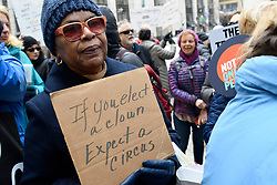 "The sign held by Jannette Barnes, of Upper Darby reads ""If You Elect A Clown Expect a Circus"" as an estimated 175 protestor gathered at the South apron of City Hall to protest President Trumps National Emergency call, during a President's Day protest, on Monday. (Bastiaan Slabbers for WHYY)"