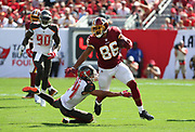 Nov 11, 2018; Tampa, FL USA: Washington Redskins tight end Jordan Reed (86) runs after a catch while Tampa Bay Buccaneers cornerback Brent Grimes (24) attempts to bring him down at Raymond James Stadium. The Redskins beat the Buccaneers 16-3. (Steve Jacobson/Image of Sport)