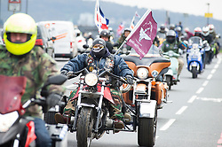 © Licensed to London News Pictures. 12/04/2019.<br /> Blackheath, UK. Hundreds of bikers ride along Shooters Hill Road, Blackheath Common, London on route to Westminster to protest against the Prosecution of British soldier F charged for the Bloody Sunday murders.  <br /> Photo credit: Grant Falvey/LNP