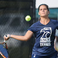 UNCW's Christine Kharkevich returns a serve against Virginia Tech Saturday September 13, 2014 at UNCW. (Jason A. Frizzelle)