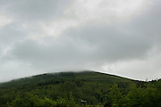 Clouds cover a hill in Northern Ireland on Saturday, June 22nd 2013. (Photo by Brian Garfinkel)