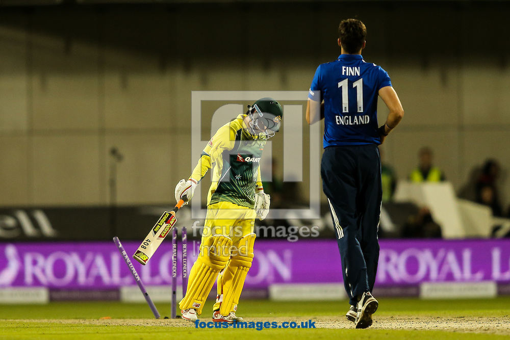 Matthew Wade of Australia (right) is bowled by Steven Finn of England (right) to complete England's victory during the 3rd One Day International match at Old Trafford Cricket Ground, Stretford<br /> Picture by Andy Kearns/Focus Images Ltd 0781 864 4264<br /> 08/09/2015
