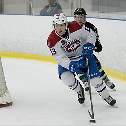KINGSTON, ON - MAR 9,  2017: Ontario Junior Hockey League, playoff game between the Cobourg Cougars and Kingston Voyageurs, Kyle Hallbauer #13 of the Kingston Voyageurs skates with the puck during the 2nd period.<br /> (Photo by Ian Dixon/ OJHL Images)