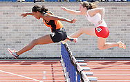 Marlboro's Courtney Warden, left, and Red Hook's Grace Weisbecker run the 100-hurdles during the Section 9 track and field state qualifier in Middletown on Friday, May 31, 2013. Both qualified for the state meet.