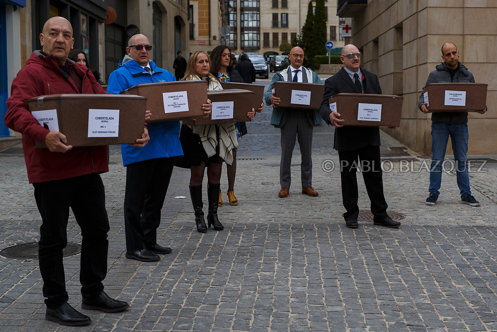 14/04/2018. Coffins containing the bodies of victims of Spain Civil War exhumed in Cobertelada and Calata&ntilde;azor are carried along the streets in center of Soria during a homage to hand the remains to their relatives on April 14, 2018 in Soria, Spain. La Asociacion Soriana Recuerdo y Dignidad (ASRD) 'The Soria Association for Memory and Dignity' celebrated a tribute to hand over the remains of civil war victims to their families. The Society of Sciences of ARANZADI helped with the research, exhumation and identification of the bodies, after villagers passed the information about the mass grave, 81 years after the assassination took place, to the ASRD. Seven people were assassinated around August 25, 1936 by Falangists, as part of General Francisco Franco armed forces, and buried in the 'Fosa de los Maestros' (Teachers Mass Grave) near Cobertelada, Soria, after being taken from prison of Almazan during the Spanish Civil War. Five of them were teachers in the region, and also friends of Spanish writer Antonio Machado. The other two still remain unidentified. Another body was assassinated by Falangists accompanied by a priest in 1936, and was exhumed on 23 September of 2017 near Calata&ntilde;azor, Soria. It belonged to Abundio Andaluz, a politician, lawyer and musician in Soria.<br /> Spain's Civil War took the lives of thousands of people on both sides, and civilians. But Franco continued his executions after the war has finished. Teachers, as part of the education sector, were often a target of Franco's forces. Spanish governments has never done anything to help the victims of the Civil War and Franco's dictatorship while there are still thousands of people missing in mass graves around the country. (&copy; Pablo Blazquez)