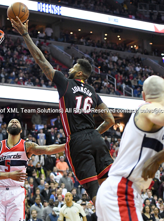 WASHINGTON, DC - APRIL 8: Miami Heat forward James Johnson (16) scores the game winning basket as time winds down in the second half against Washington Wizards center Marcin Gortat (13) on April 8, 2017, at the Verizon Center in Washington, D.C.  The Miami Heat defeated the Washington Wizards 106-103.  (Photo by Icon Sportswire)