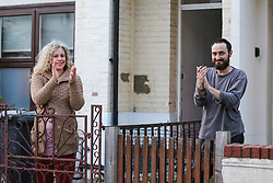 © Licensed to London News Pictures. 23/04/2020. London, UK. Members of the public in Haringey, north London take part in 'Clap For Our Carers' by applauding NHS staff, carers and key workers. The campaign has been encouraging people across the UK to take part in a round of applause from their windows, doors and front gardens to show their appreciation for the efforts of the NHS staff, carers and key workers during the COVID-19 pandemic. Photo credit: Dinendra Haria/LNP
