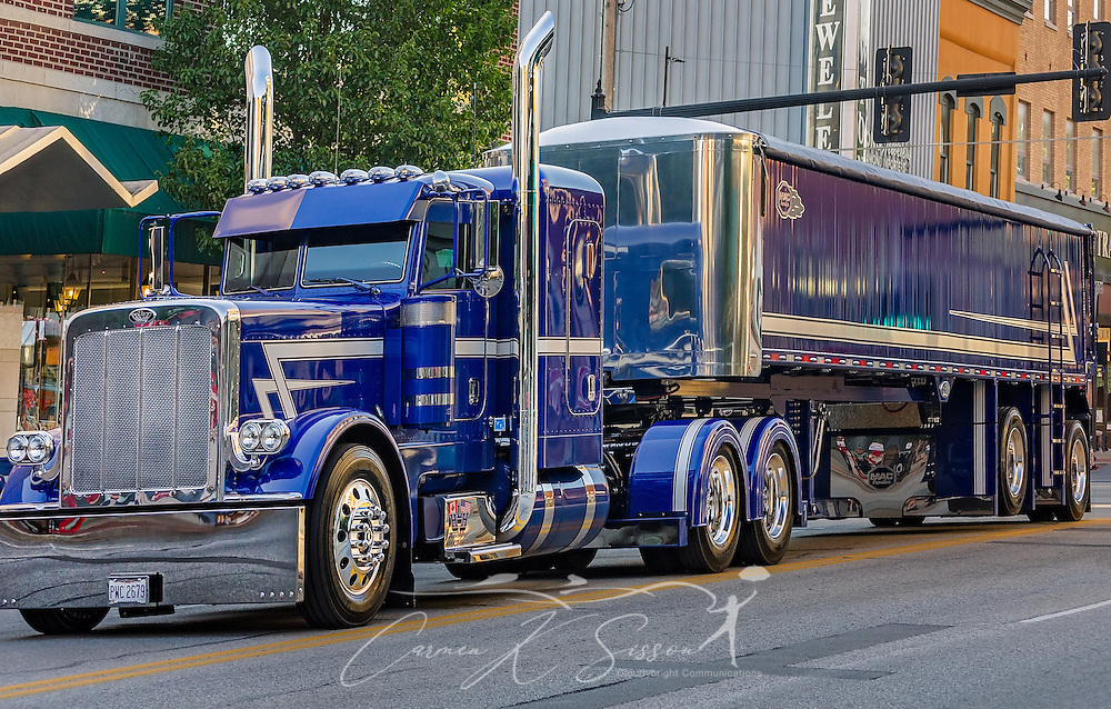 "HLH Trucking drives their 2015 Peterbilt 389 with a 2017 MAC End Dump down Main Street during the 34th annual Shell Rotella SuperRigs parade, June 10, 2016, in Joplin, Missouri. SuperRigs, organized by Shell Oil Company, is an annual beauty contest for working trucks. Approximately 89 trucks entered this year's competition. HLH took first place in the ""Best Lights"" category. (Photo by Carmen K. Sisson/Cloudybright)"