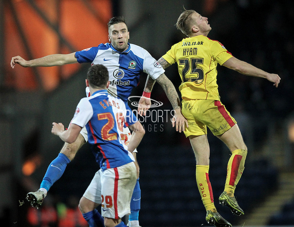 Luke Hyam (Rotherham United) jumps with Shane Duffy (Blackburn Rovers) to win the header during the Sky Bet Championship match between Blackburn Rovers and Rotherham United at Ewood Park, Blackburn, England on 11 December 2015. Photo by Mark P Doherty.