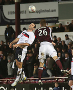 Dundee's Gary Harkins  and Hearts; Marius Zaliukas  - Hearts v Dundee in the Clydesdale Bank, Scottish Premier League at Tynecastle.. - © David Young - www.davidyoungphoto.co.uk - email: davidyoungphoto@gmail.com