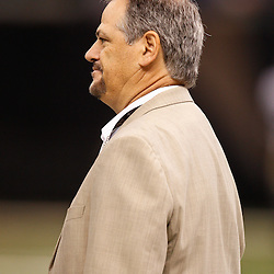 August 27, 2010; New Orleans, LA, USA; New Orleans Saints general manager Mickey Loomis watches from the field prior to the start of a preseason game at the Louisiana Superdome. The New Orleans Saints defeated the San Diego Chargers 36-21. Mandatory Credit: Derick E. Hingle