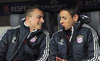 FUSSBALL  CHAMPIONS LEAGUE  ACHTELFINALE  HINSPIEL  2012/2013      FC Bayern Muenchen - FC Arsenal London     13.03.2013 Gute gelaunt auf der Ersatzbank: Xherdan Shaqiri (li) und Rafinha (re, beide FC Bayern Muenchen)