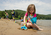 Lexie Kulacz making sand castles along the shore at Ellacoya State Park Beach on Friday.  (Karen Bobotas/for the Laconia Daily Sun)