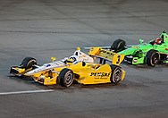 Helio Castroneves (3) holds off James Hinchcliffe (27) during the IZOD IndyCar Iowa Corn Indy 250 auto race at the Iowa Speedway in Newton, Iowa on Saturday, June 23, 2012.
