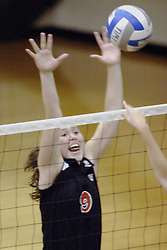 27 October 2006: Ali Crouch gives her all to block a strike coming her way. The Bears won the match 3 games to 1. The match between the Washington University Bears and the Illinois Wesleyan Titans took place at Shirk Center on the IWU campus in Bloomington Illinois.<br />