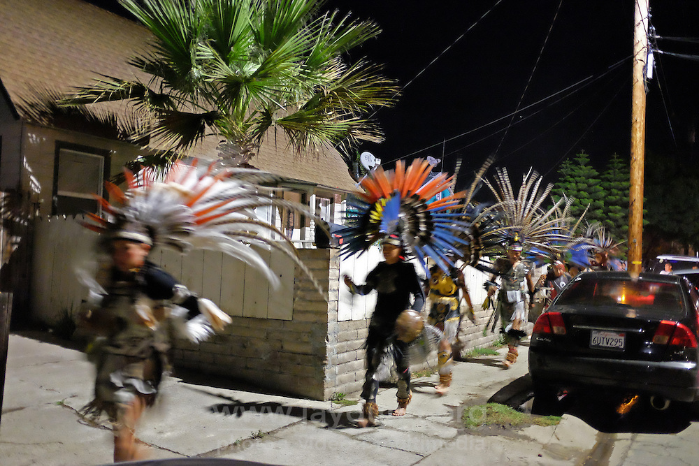 Dancers from Aztec group Yaocuauhtli take part in a healing march through one of Salinas' most troubled neighborhoods, touching upon the sites of nine shootings. The procession was part of a Day of the Dead remembrance at the nearby Alisal Center for the Fine Arts.