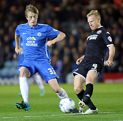 Chris Forrester of Peterborough United puts pressure on David Perkins of Wigan Athletic - Mandatory byline: Joe Dent/JMP - 07966 386802 - 20/10/2015 - FOOTBALL - ABAX Stadium - Peterborough, England - Peterborough v Wigan - Sky Bet League One