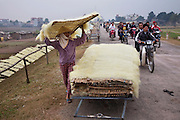 A woman places rice noodles on racks and sets them out dry in So village, SW of Hanoi, Vietnam. (From the book What I Eat: Around the World in 80 Diets.)