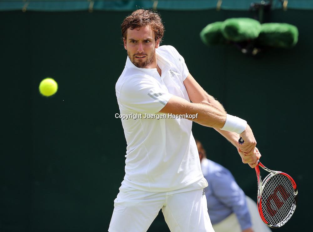 Wimbledon Championships 2014, AELTC,London,<br /> ITF Grand Slam Tennis Tournament,<br /> Ernests Gulbis (LAT),Aktion,Einzelbild,<br /> Halbkoerper,Querformat,