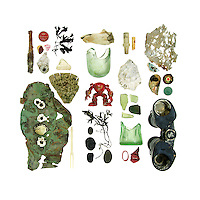 Rusted metal pin, bottle caps, beach china, sea glass, Northern Rock Barnacle (Balanus balanoides), driftwood, bone, action figure, Knotted Wrack (Ascophyllum nodosum), asphalt beach stone, schist beach stones, electrical fittings, oyster shell, mid-20th-century Coke-bottle base, lobster-claw band, plastic toy bit, eroded aluminum, Blue Mussel (Mytilus edulis), U.S. quarter (patinated), and binoculars.<br />